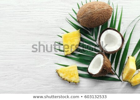 Composition from juicy half of pineapple and green palm leaf on  Stock photo © artjazz