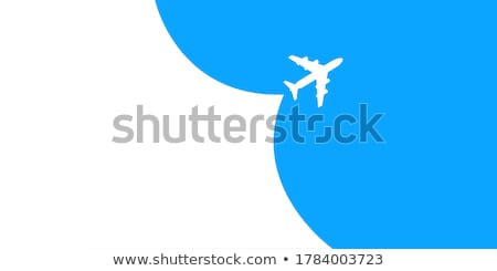 white condensation trail from a commercial airplane as it flies stock photo © monkey_business