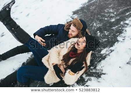 Young woman rides ice skates in the park Stock photo © boggy
