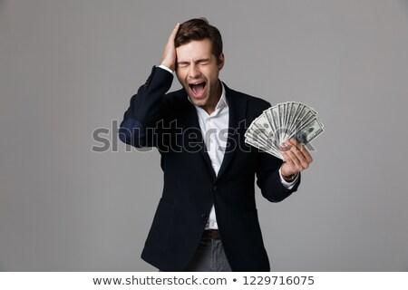 Kép izgatott üzletember 30-as évek öltöny mosolyog Stock fotó © deandrobot