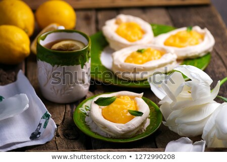 egg shaped meringue nests with lemon curd.traditional easter pastries.  Stock photo © zoryanchik