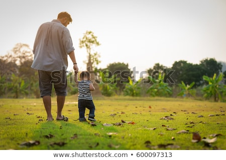 Happy father and little boy walking in summer park. adoption and people concept Stock photo © galitskaya
