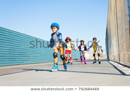 A girl playing roller skate Stock photo © bluering