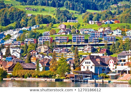 Modern Swiss lakeside village waterfront view stock photo © xbrchx