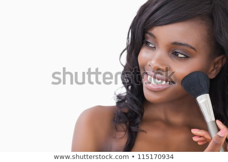 young smiling woman with make up brushes isolated on white stock photo © artjazz