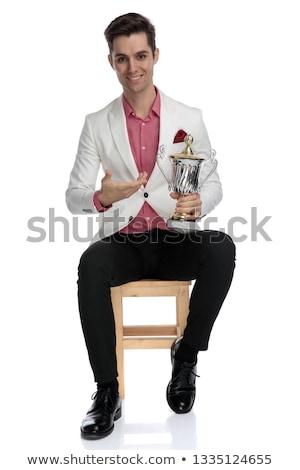 Lächelnd eleganten Mann Sitzung Trophäe Stock foto © feedough