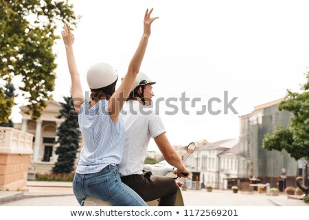 Arkadan görünüm mutlu kaza kask binicilik Stok fotoğraf © deandrobot