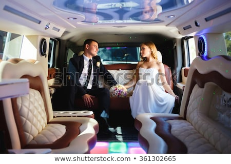 colorful image of beautiful couple sitting in a limousine stock photo © konradbak