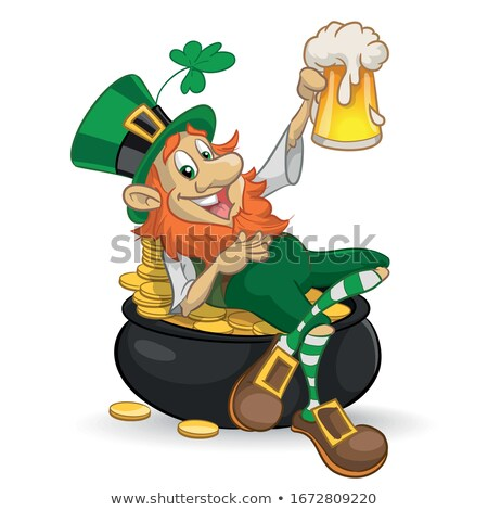 Leprechaun with a pot of gold and clover stock photo © heliburcka