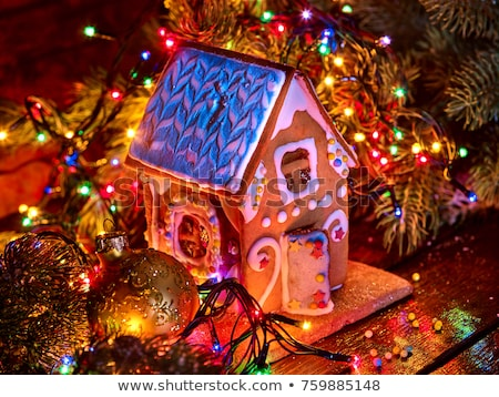 close up of christmas gingerbread house at home stock photo © dolgachov