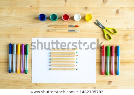 colorful gouaches paintbrushes scissors crayons on paper and highlighters stock photo © pressmaster