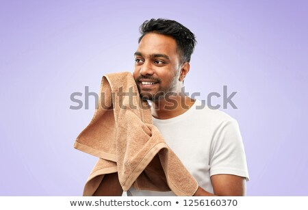 indian man with bath towel over violet background Stock photo © dolgachov