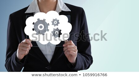 businesswoman holding tablet with cog gears clouds stock photo © wavebreak_media