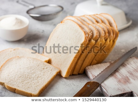Cut of fresh loaf of white bread on white background. Traditional bakery heritage. Stock photo © DenisMArt