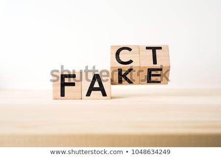 Branco fato falsificação cubo Foto stock © Oakozhan