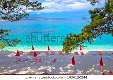 baska idyllic pebble beach and town of baska view stock photo © xbrchx