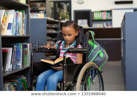 Elöl kilátás iskolás lány olvas könyv könyvtár Stock fotó © wavebreak_media