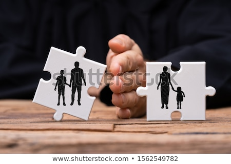 Dividing Two Jigsaw Puzzle Pieces Showing Divorce Concept Stock photo © AndreyPopov