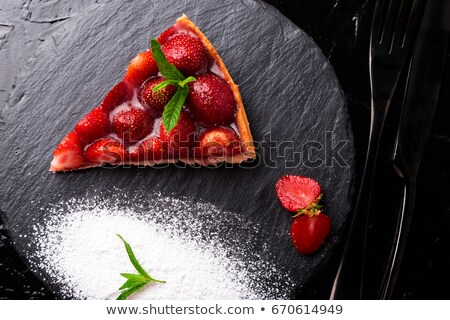 Strawberry pie on black slate plate. Stock photo © Illia