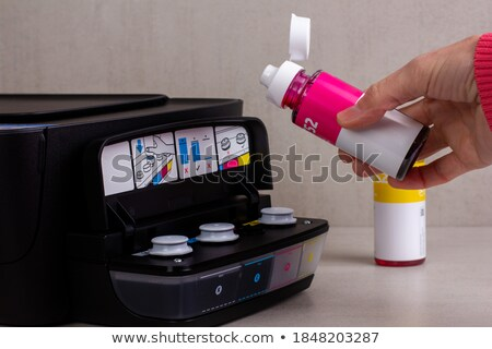 Pouring ink into industrial printing machine Stock photo © pressmaster