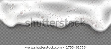 Cerveza burbujas espuma transparente amarillo alimentos Foto stock © ShustrikS