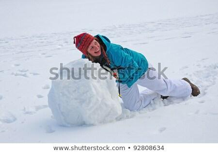 Genç kadın dev kartopu kardan adam kız Stok fotoğraf © galitskaya