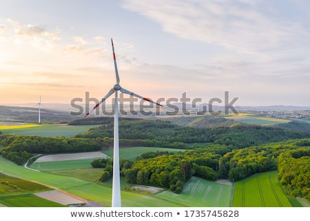 wind turbine in green hill Stock photo © Ansonstock