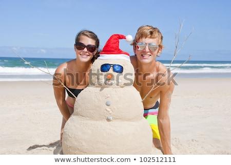 Sable construire bonhomme de neige lunettes de soleil oiseaux oeil Photo stock © KonArt