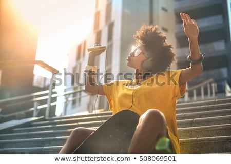 девушки · расслабляющая · музыку · улице · красивой - Сток-фото © absoluteindia
