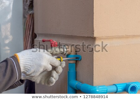 Male plumber using clamp Stock photo © photography33