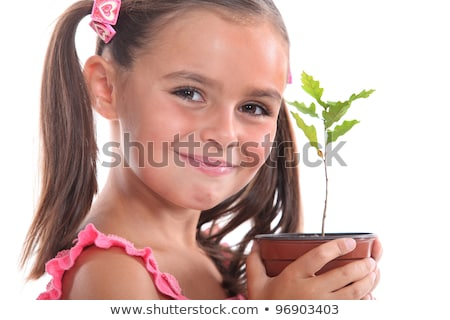 young girl with an oak sapling stock photo © photography33