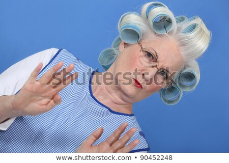 grandmother with hair curlers against blue background Stock photo © photography33