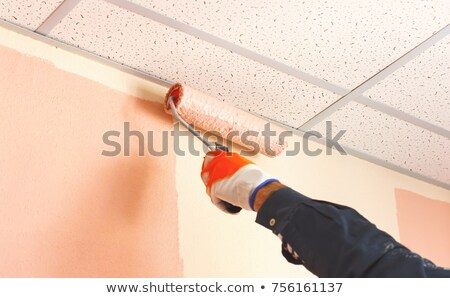 Stock photo: Painter using roller on ceiling