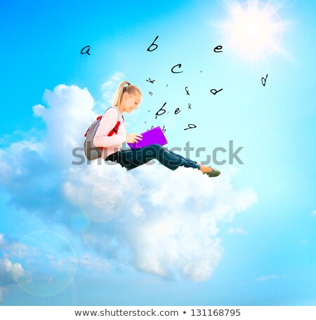 Stock photo: child with notebook on blue sky
