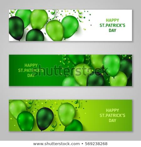 Green balloon and confetti Stock photo © ivonnewierink