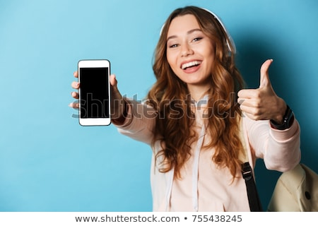 Woman dancing and giving thumbs up stock photo © stryjek