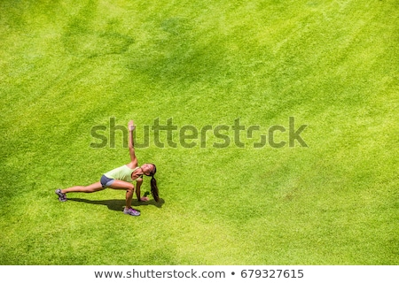 runner stretching on grass stock photo © photography33