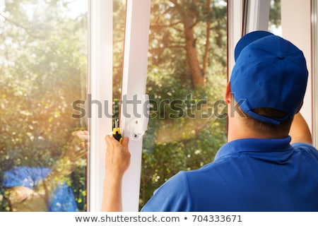 Worker installing new windows Stock photo © photography33