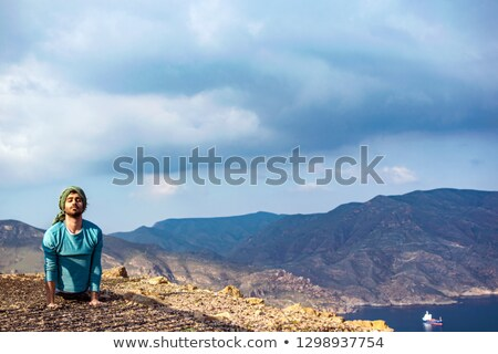Sportsman is stretching on top of hill Stock photo © vetdoctor
