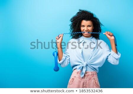 Donna mordere cavi rabbioso donna d'affari elettrici Foto d'archivio © smithore