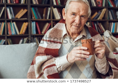 a pensive man drinking a cup of coffee stock photo © photography33