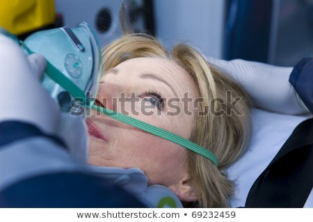 Close-up of a female patient receiving oxygen mask Stock photo © wavebreak_media