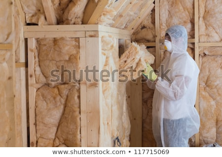 Worker filling walls with insulation material in construction site Stock photo © wavebreak_media