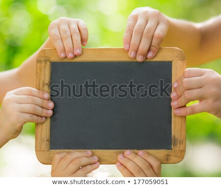 Partnerships and Teamwork with a blank sign Stock photo © Lightsource