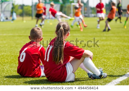 Stock photo: football girl sitting