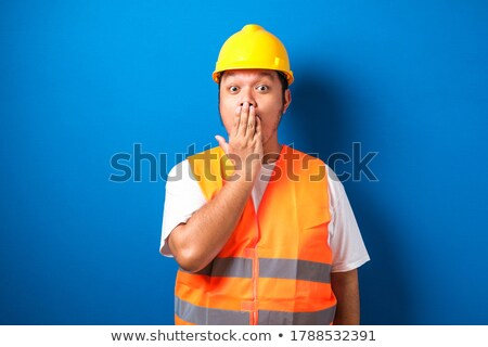 Engineer looking at his hand in amazement Stock photo © photography33