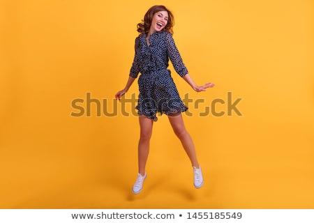 mooie · vrouw · poseren · Geel · interieur · kamer - stockfoto © pilgrimego