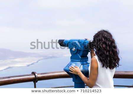 Side view of girl holding telescope Stock photo © zzve