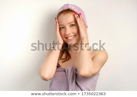 Young girl shyly covered her face with her hands Stock photo © Discovod