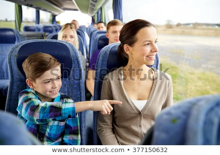 Mother and son travel by bus. Stock photo © d13